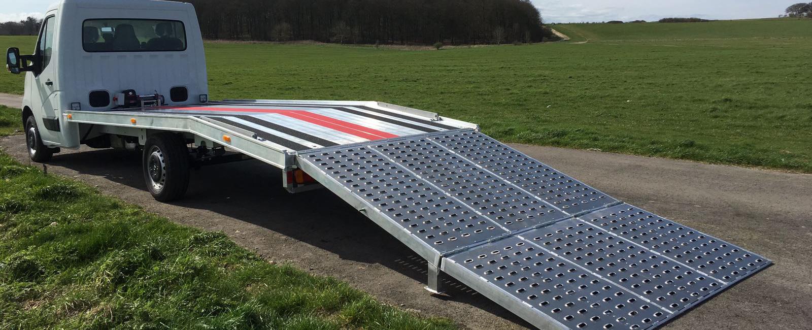 Ground maintenance vehicle - ramp down