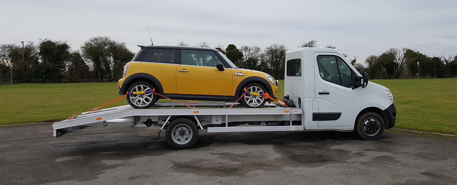 Mini loaded onto recovery truck