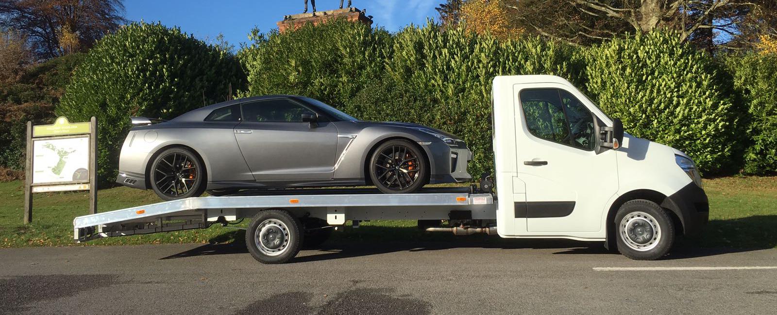 Sports Car loaded onto Car Transporter